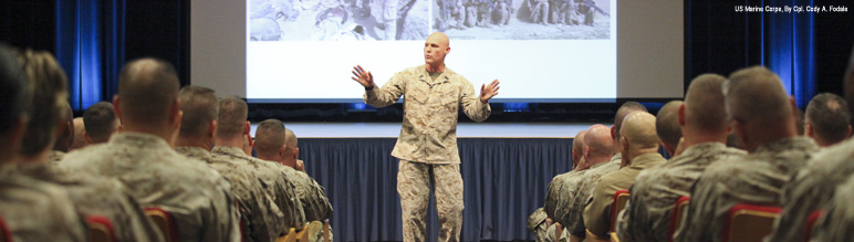 A Sergeant Major speaks to Marine officers and staff noncommisioned officers.